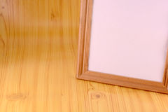 Photo frame on old wooden wall Royalty Free Stock Image