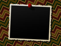 Photo frame over a knitted background Stock Photography