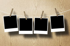 Photo frame paper attach rope on wood background stock image
