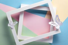 Photo frame on pastel paper. Flatlay stock image