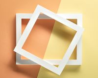 Photo frame on pastel paper. Flat lay royalty free stock images