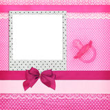 Photo frame and pink pacifier Royalty Free Stock Images