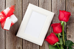 Photo frame, red roses and Valentines day gift Stock Image