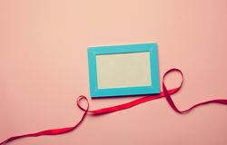 Photo frame and romantic ribbon Stock Photo