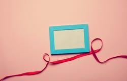 Photo frame and romantic ribbon Stock Photo