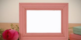 Photo frame, rose flower and gift boxes on a table. Empty photo frame, rose flower and gift boxes on a table stock image