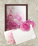Photo frame with roses and paper Royalty Free Stock Image