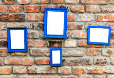 Photo frame on rustic old brick wall Stock Image