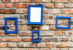 Photo frame on rustic old brick wall Royalty Free Stock Images
