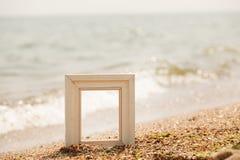 Photo frame on sand beach Stock Image