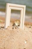 Photo frame on sand beach Royalty Free Stock Photo