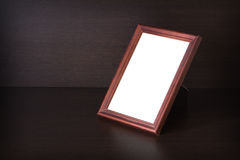 The Photo frame standing on the table Stock Images