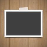 Photo frame stick on vintage wooden texture. Vector illustration Stock Images
