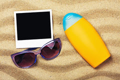 Photo frame, sunblock and sunglasses Royalty Free Stock Image