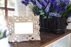 Photo frame on the table Royalty Free Stock Photos
