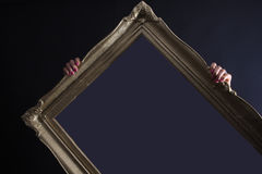 Photo frame and two hands Royalty Free Stock Image