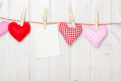 Photo frame and valentines day toy hearts Stock Image