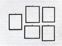 Photo frame on the vertical white brick wall Royalty Free Stock Photos