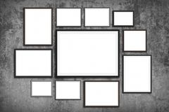 Photo frame wall mock up - set of picture frames on vintage wall background.  stock photo