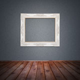 Photo frame in vintage room. Photo frame on the wall in vintage room background stock image