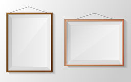 Photo frame on white wall Royalty Free Stock Photography