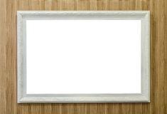Photo frame. White photo frame on Wood Wall Stock Photography