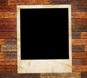 Photo frame on the wood Stock Image