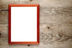 Photo frame on wood Stock Images