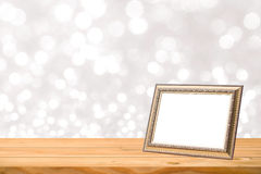 Photo frame. On wood table blur background Stock Image