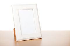 Photo frame on wood table Royalty Free Stock Photos