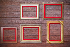 Photo frame on wood wall Stock Image