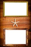 Photo frame on wood wall texture. Stock Image