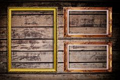 Photo frame on wood wall texture. Royalty Free Stock Photos