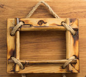 Photo frame on wood Royalty Free Stock Image