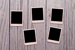 Photo frame on wooden background Royalty Free Stock Photo