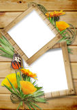 Photo frame on a wooden background with butterflie Stock Image