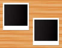 Photo frame on wooden background Stock Photos