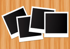 Photo frame on wooden background Stock Image