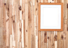 Photo frame on wooden board Royalty Free Stock Photography