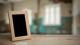 Photo frame on the wooden table Royalty Free Stock Photography