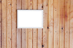 Photo frame on wooden wall Royalty Free Stock Images