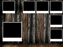 Photo frame on wooden wall Royalty Free Stock Photography