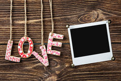 Photo frame and the word love for Valentine holiday Royalty Free Stock Photo