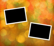 Photo frames. On a paper with background lights Royalty Free Stock Photo