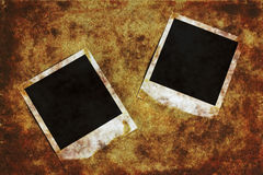 Photo frames. Old instant camera photo frames on the grunge background stock photos
