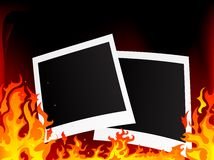 Photo frames. Blank photo frames on fiery background Royalty Free Stock Image