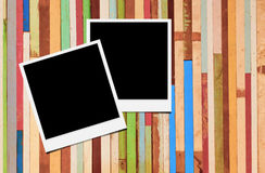 Photo frames. Blank instant photo frames on wooden background stock photo