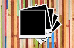 Photo frames. Blank instant photo frames on wooden background royalty free stock photography