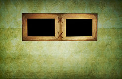 Photo frames. On the grunge wall Stock Images
