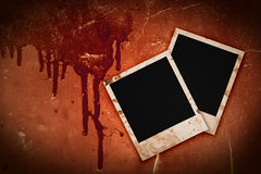 Photo frames on bloody grunge background. Old Polaroid photo frames on bloody grunge background Stock Photography